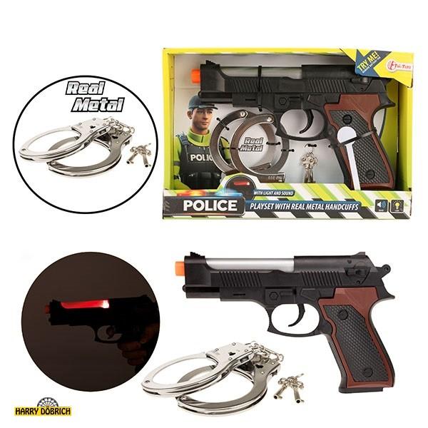 Pistole mit Metallhandschellen